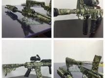 Geweer met camouflage dip